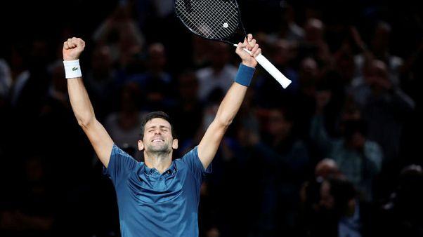 Intense Djokovic staves off major Cilic challenge