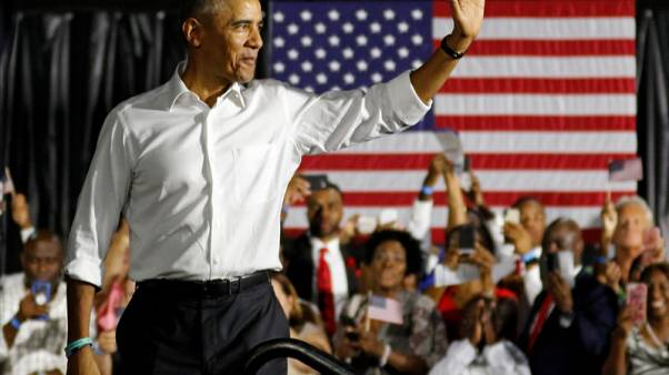 Obama warns against fear, Trump touts economy on campaign trail