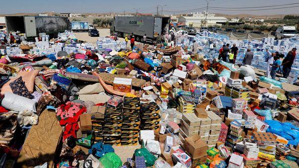 U.N. aid trucks reach remote Rukban camp in Syria - local source