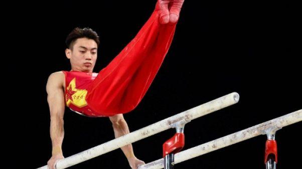 Mondiaux de gymnastique: le Chinois Zou Jingyuan conserve son titre aux barres parallèles