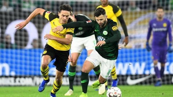 Dortmund go four points clear with win at Wolfsburg