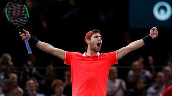 Khachanov shocks Djokovic to win Paris crown