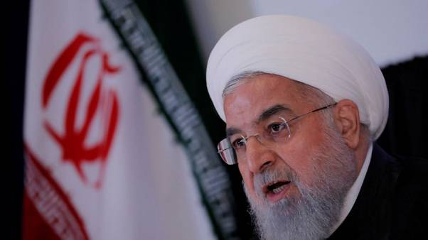 Rouhani says Iran to sell oil, defy U.S. sanctions - TV