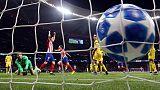 Atletico snap Dortmund's unbeaten run with 2-0 win