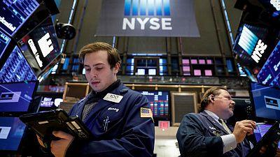 World stocks rise after U.S. vote splits power; dollar slips