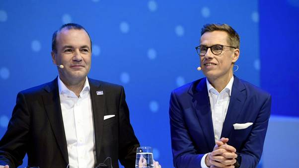 Reserved Bavarian, sporty Finn seek centre-right ticket for EU's top job