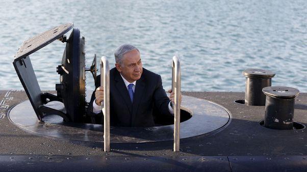 الشرطة الإسرائيلية توصي باتهام محامي نتنياهو بالرشوة في صفقة غواصات