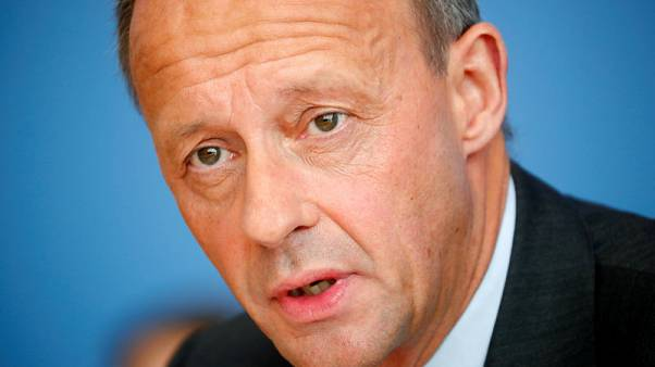 Conservative Merz says Germany benefits from 'weak' euro