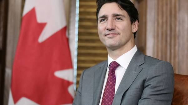 Canada PM talks of possible action to halt postal workers' strikes