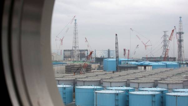 Fukushima tests to help assess cooling of damaged reactors - Tepco