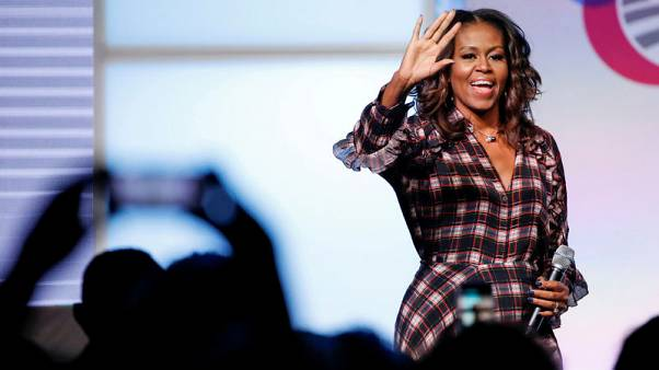 In memoir, Michelle Obama says she'll never forgive Trump birther claims