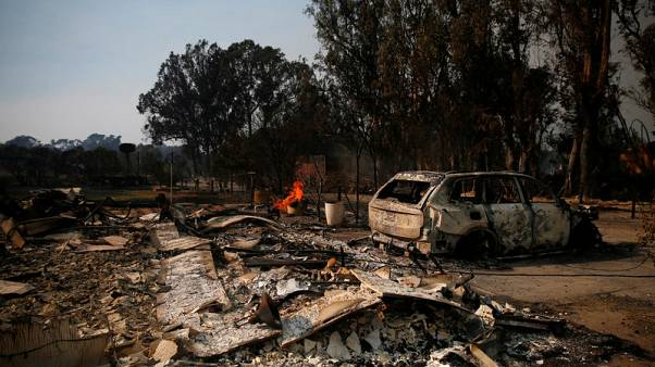 Crews fight to save homes from massive California wildfires