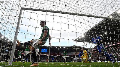 Late Bamba strike gives Cardiff win over 10-man Brighton