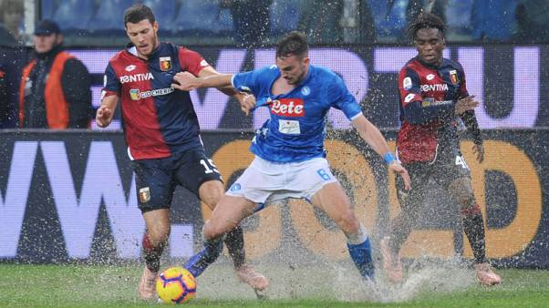 Napoli splash their way to a 2-1 win at Genoa