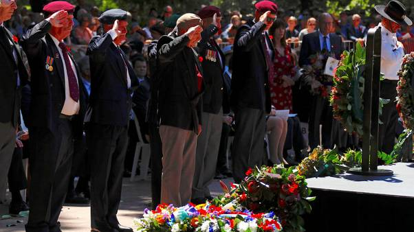 Thousands mark WW1 Armistice in Australia, unbowed by attack
