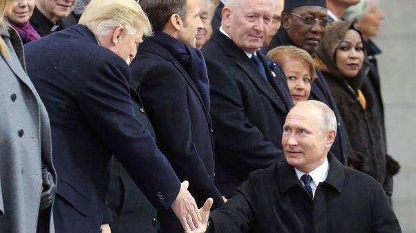 بوتين يقول إنه أجرى محادثات مع ترامب في باريس
