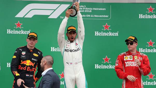 Hamilton wins in Brazil as Mercedes take fifth F1 title