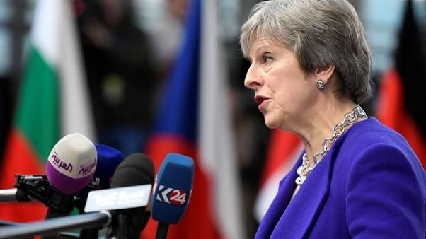May says Britain open to 'different relationship' with Russia