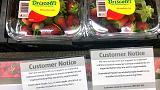 Australia charges woman with using needles to contaminate strawberries