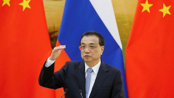 الصين تقول إنها ستفتح اقتصادها أكثر وتنتقد تنامي الحماية التجارية