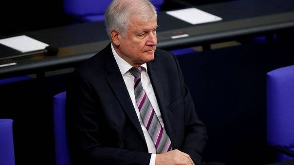 Merkel critic Seehofer to step down as Bavarian conservative chief