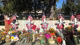 Carpenter erects wooden crosses in honour of shooting rampage victims