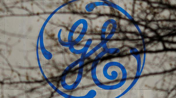 Baker Hughes, GE fall after offering priced at discount