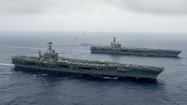 U.S. carriers join up in East Asia for 'complex' warfare drills