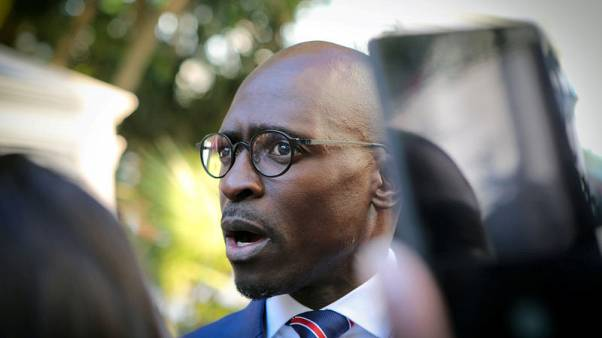 South Africa's former home affairs minister resigns from parliament