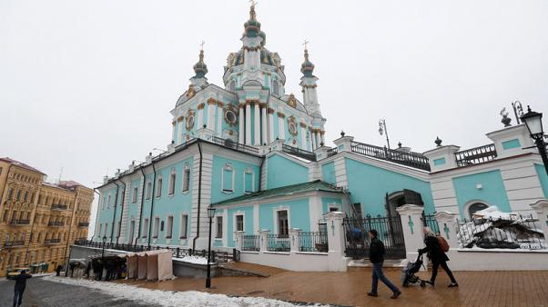 Petrol bombs lobbed at Kiev church as Russia row festers