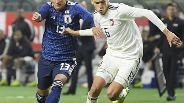 Late Venezuelan penalty clinches draw against Japan
