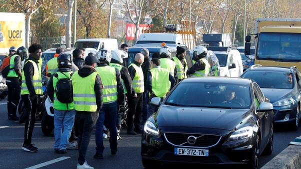 French protesters rail against Macron's fuel taxes with road blocks