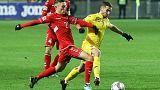 Romania outclass Lithuania to keep alive promotion hopes