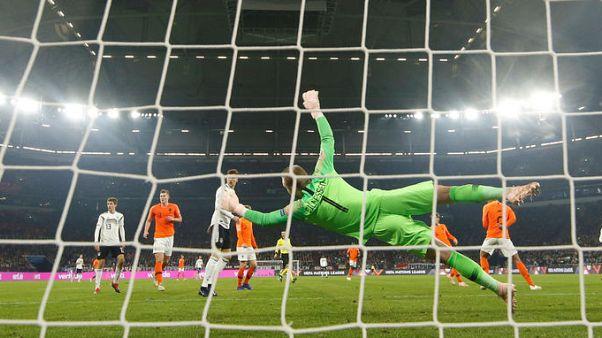 Soccer-Late goals earn Dutch spot in Nations League finals