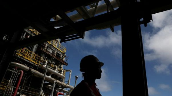 Oil prices edge up on expected OPEC supply cuts