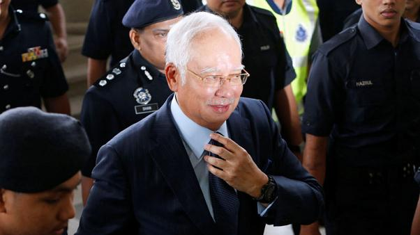 Malaysia reopens submarine probe, questions former PM Najib