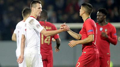 Milik's twice-taken penalty gives relegated Poland draw in Portugal