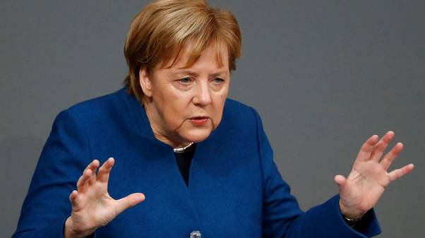 Merkel brands opponents of U.N. migrant pact 'nationalists'