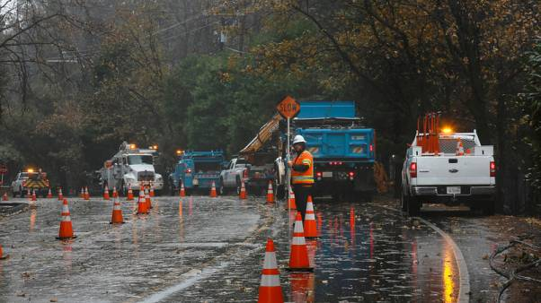 First rain in months douses California wildfire, raises risk of mudslides