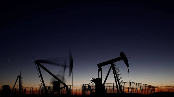 Oil prices pressured by rising U.S. crude stocks, but expected OPEC supply cut supports