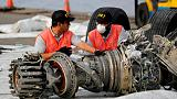 Indonesia keeps up search for crashed jet's black box as signal drops out