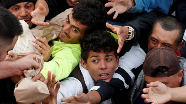 Tensions rise at U.S.-Mexico border as migrants, holiday travellers wait to cross