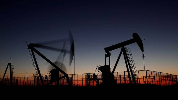 Oil prices hit year low as OPEC considers output cut
