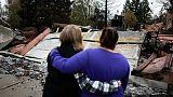 More rain helps put out California fires, but raises landslide risk