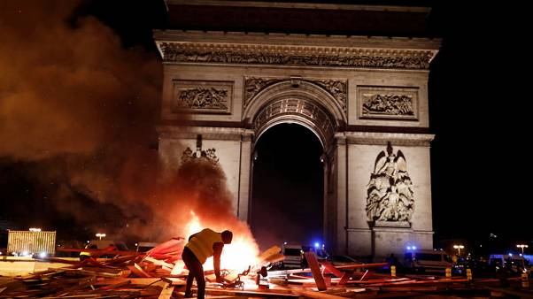 French police clash violently with protesters on Champs Elysees over petrol costs