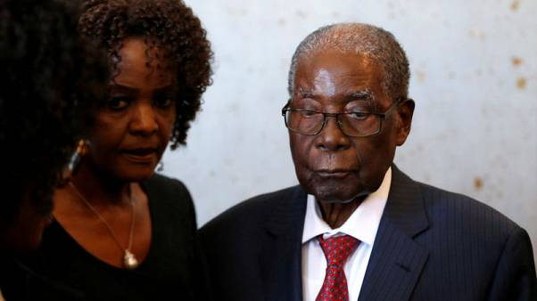 Zimbabwe's Mugabe in Singapore for medical treatment, unable to walk