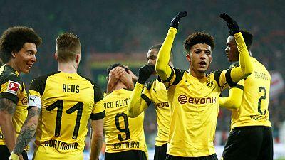 Soccer - Alcacer scores again as Dortmund edge past Mainz 2-1