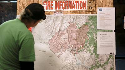 Rain breaks, easing search for remains of California wildfire