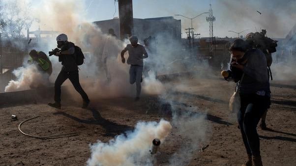 U.S. fires tear gas into Mexico to repel migrants, closes border gate