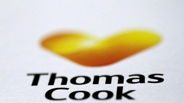 Thomas Cook cuts profit forecast, suspends dividend on weak British market
